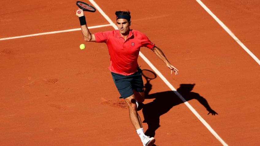 Roger Federer reacts to beating Marin Cilic at French Open
