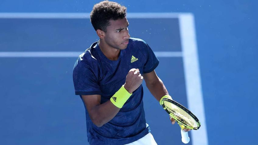 Felix Auger-Aliassime reacts to saving three match points in Cameron Norrie win