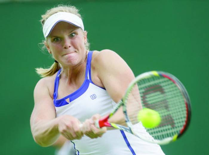 Tennis - Melanie Oudin crashes out in first round to Larcher de Brito at Wimbledon