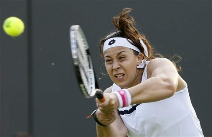 Tennis - French woman Marion Bartoli advances to the third round of Wimbledon