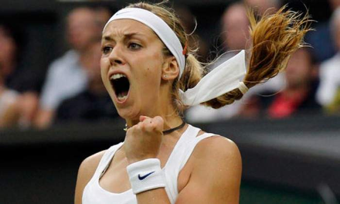 Sabine Lisicki beats Elena Vesnina in straight sets at Wimbledon