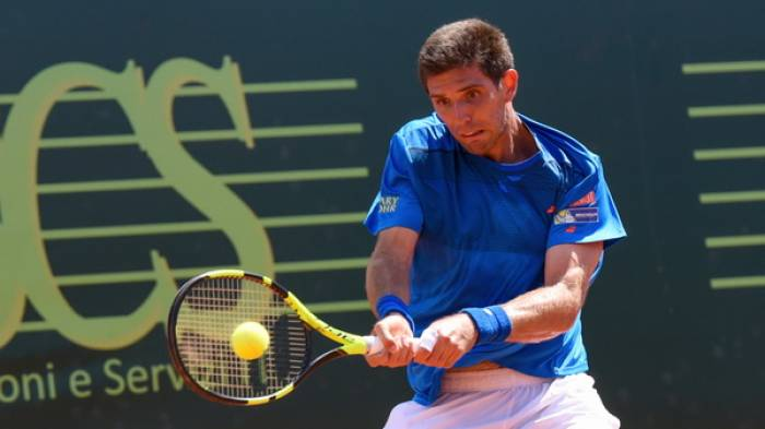 Guido Pella and Federico Delbonis set all-Argentinian final in Milan