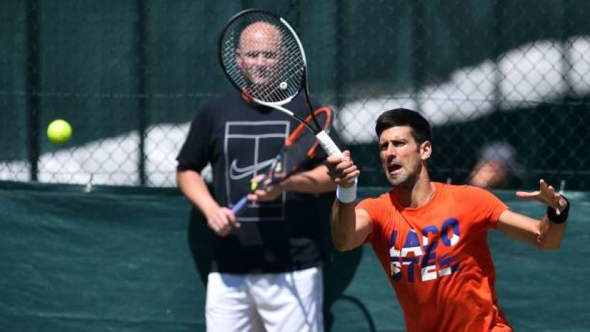 Suffering shoulder injury, Andre Agassi won't fly to Australia this year