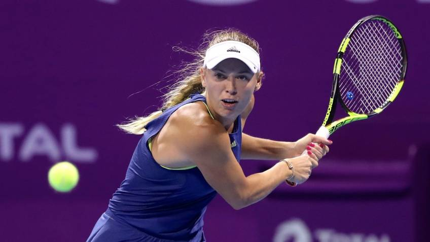 Halep wins on return, Wozniacki cruises