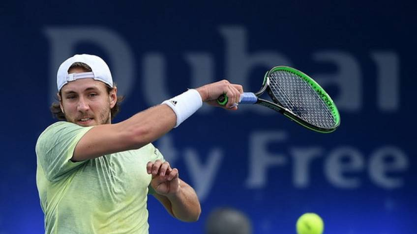 Rain's A Pain As Pouille Makes Dubai Final