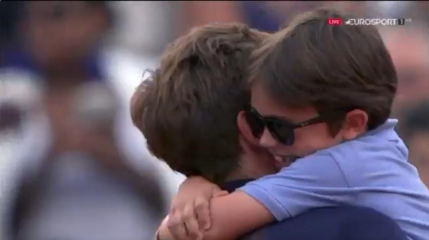 Emotional moment: Nicolas Mahut hugged his son after win