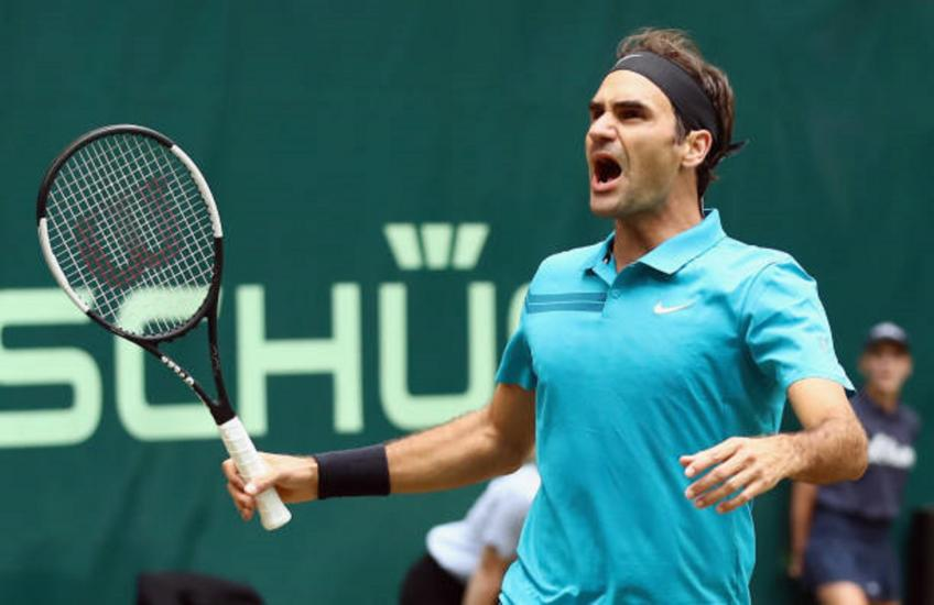 Federer saves two match points in Halle win over Paire