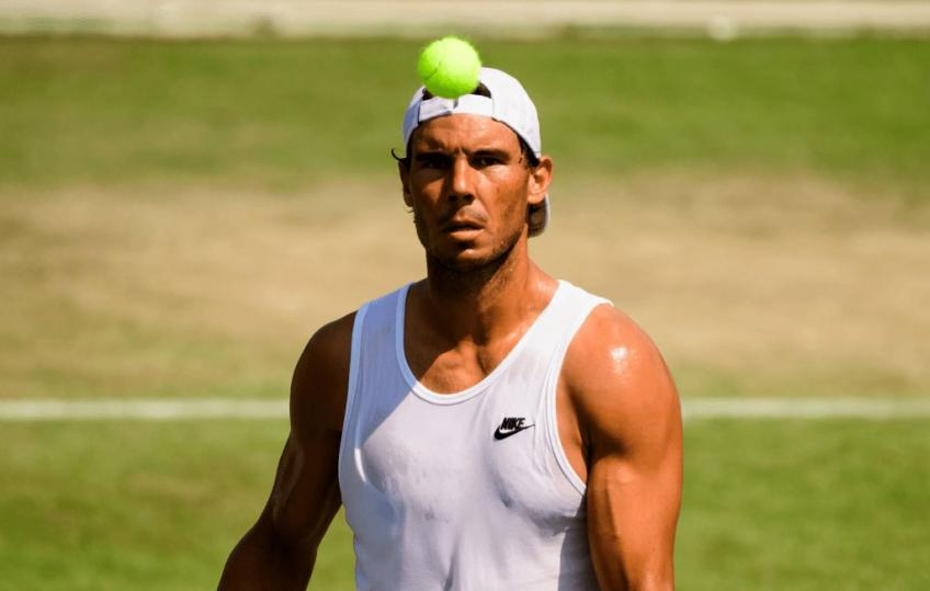 Rafael Nadal and Novak Djokovic in action on Wimbledon Day two