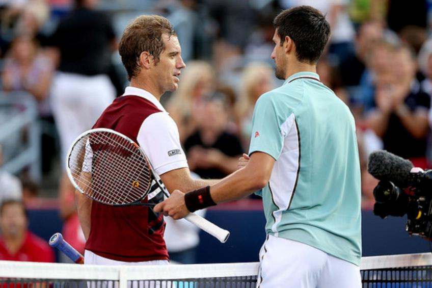 Djokovic gets through on hot day; Federer next at US Open