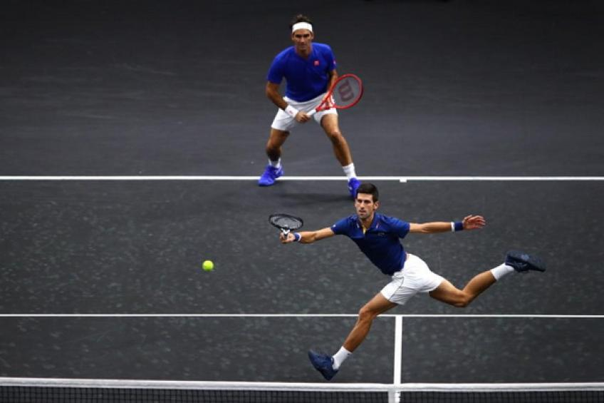 Novak Djokovic hits Roger Federer with shot during Laver Cup during doubles