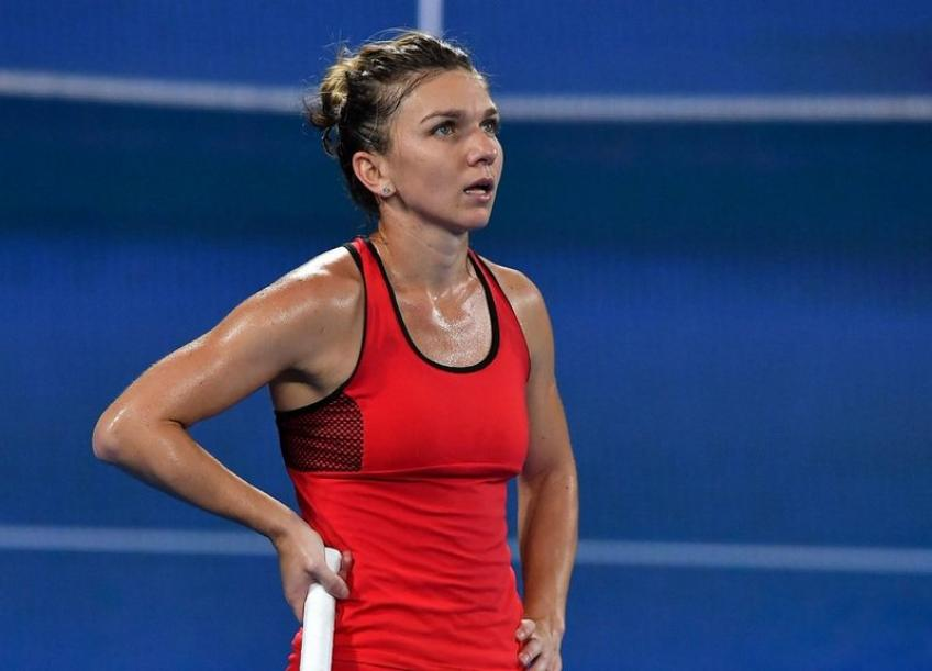 Wta Beijing: Simona Halep forced to retire to Ons Jabeur