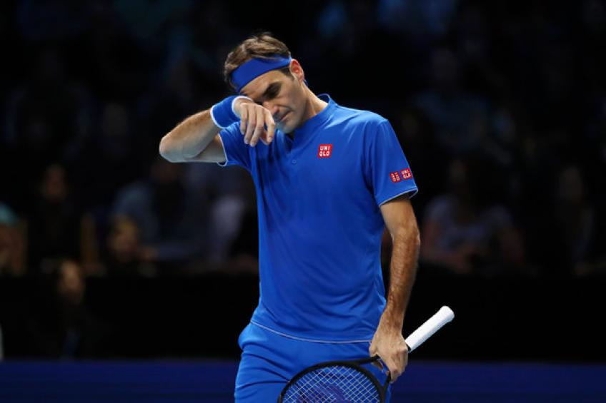 Federer dodges early exit from ATP Finals, crushes Thiem