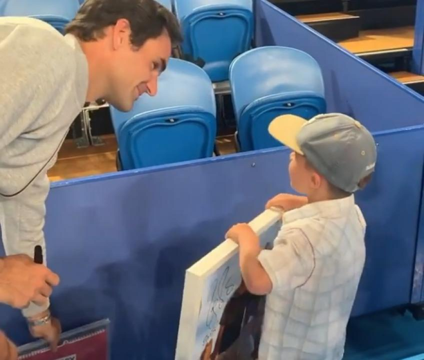 Young fan meets Roger Federer twice, gets emotional
