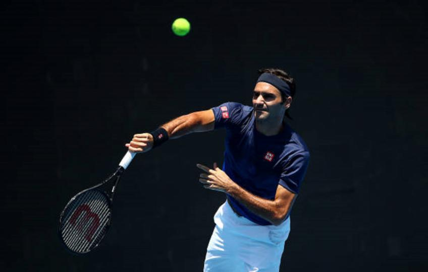Federer fends off British 'mirror' Evans to advance