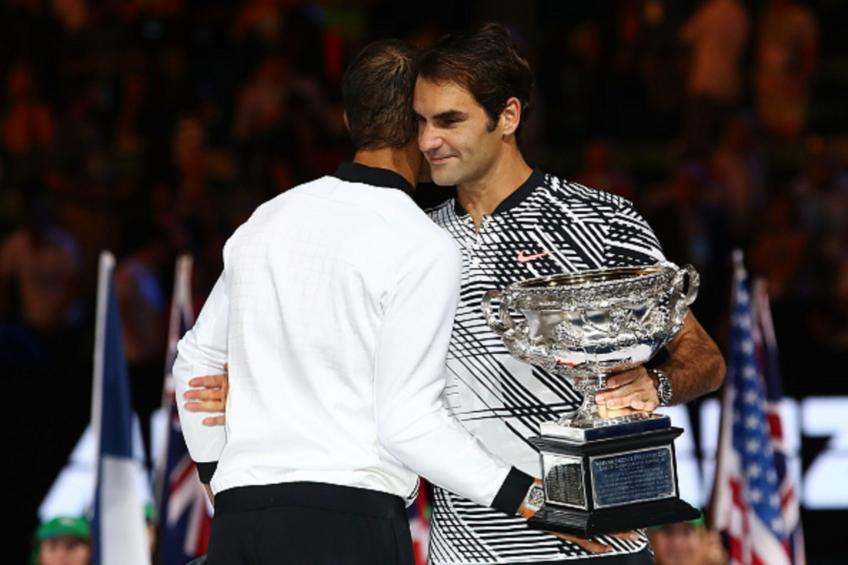 Federer digs deep to overcome Evans in Australia