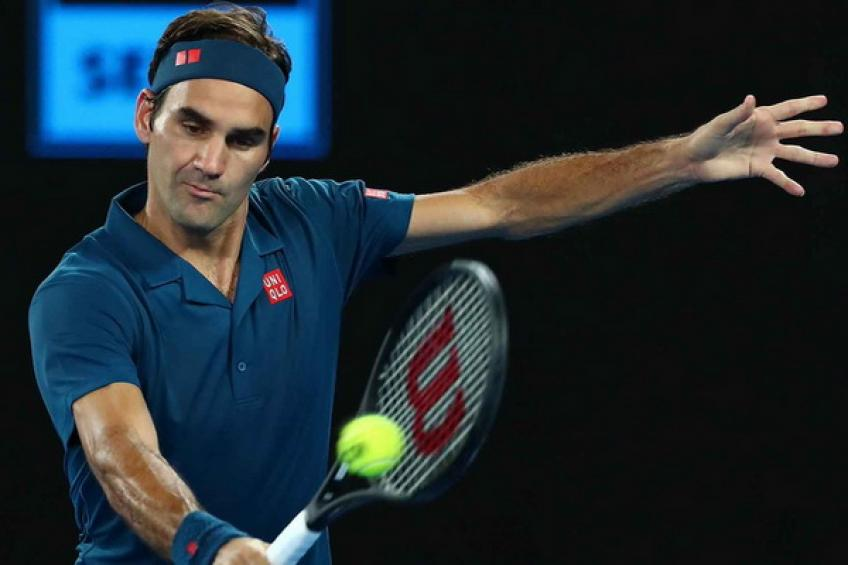 Federer relieved to get past 'mirror' Evans