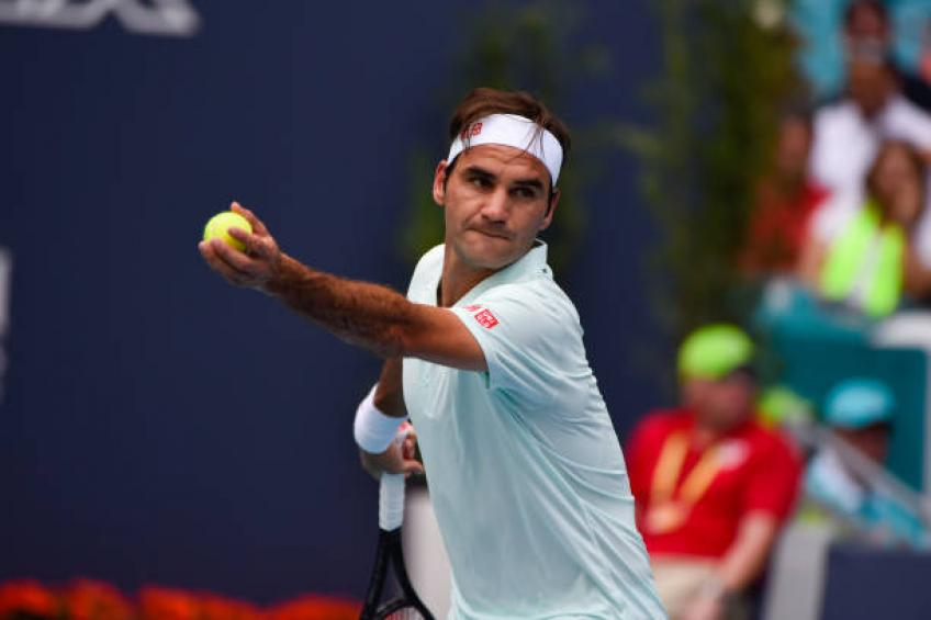 Federer cruises on while Halep advances to semi-finals