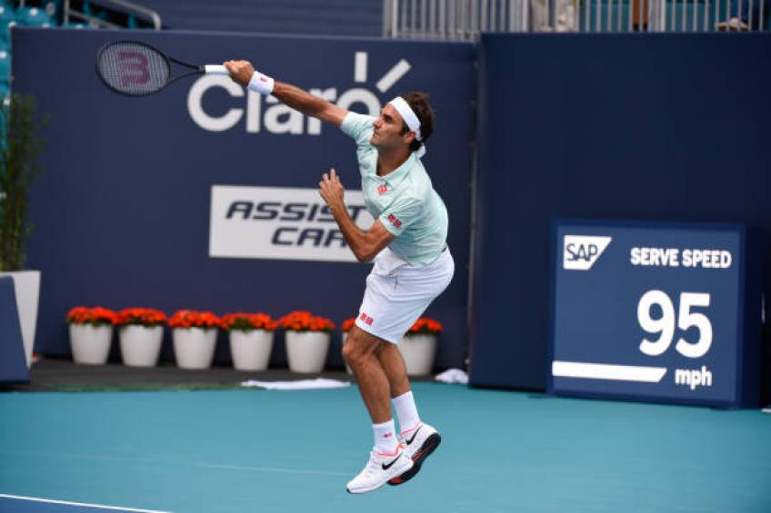 Federer storms past limping Isner to claim fourth Miami title