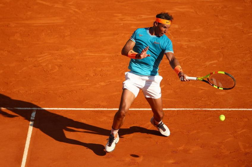 Nadal battles from set down to reach last 16