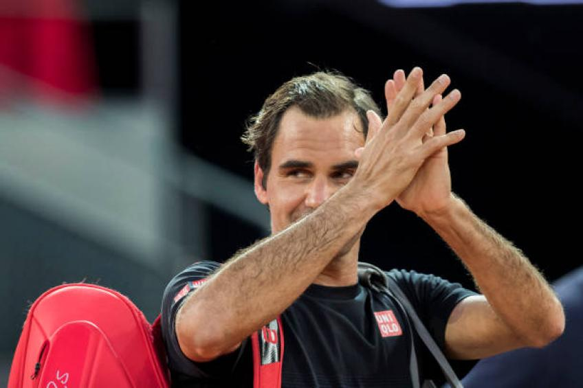 Federer saves two match points to beat Monfils in Madrid