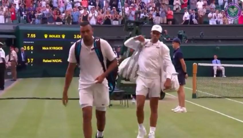 Rafael Nadal waits for Nick Kyrgios before leaving the court
