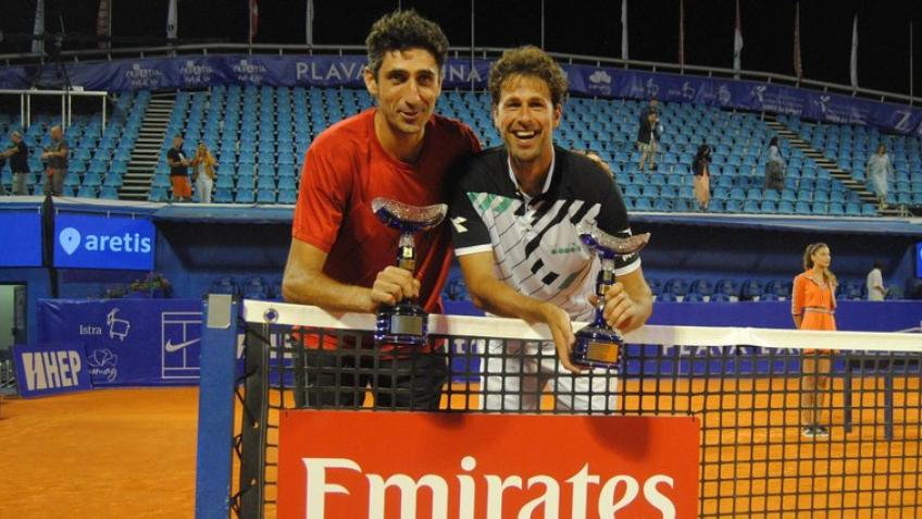 Robin Haase reacts to winning Umag doubles title with Philipp Oswald