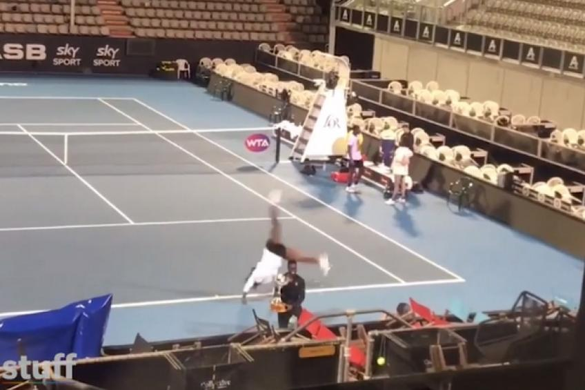 Serena Williams performs a cartwheel at an empty stadium in Auckland