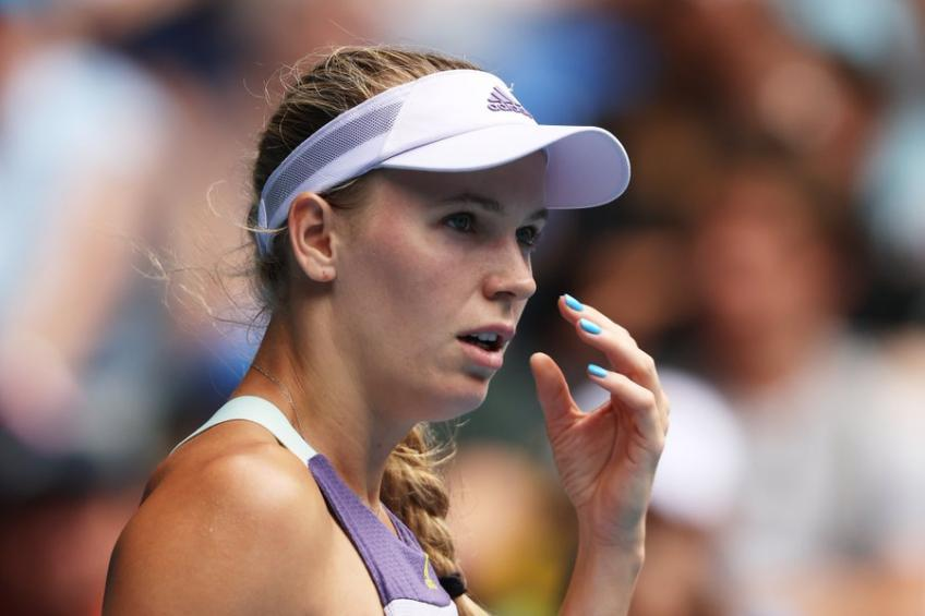 Teary Wozniacki retires after Open loss