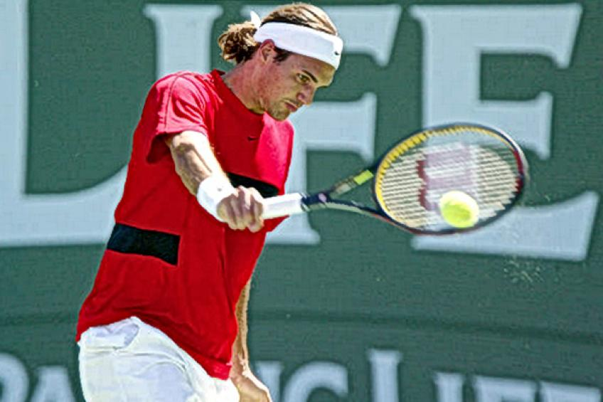 Rafael Nadal sits in Roger Federer's box during Indian Wells 2004