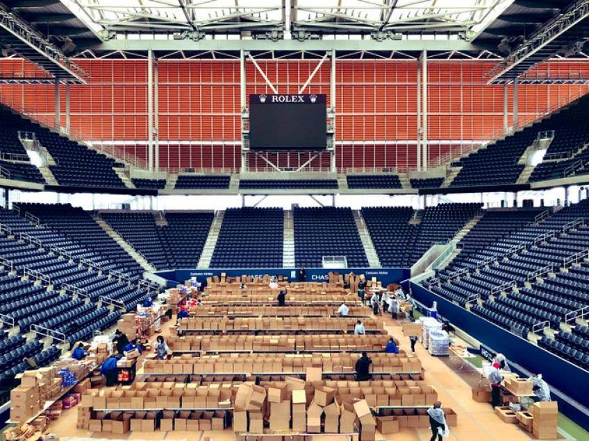 Louis Armstrong Stadium Being Used to Prepare Food Packages for Frontline Workers
