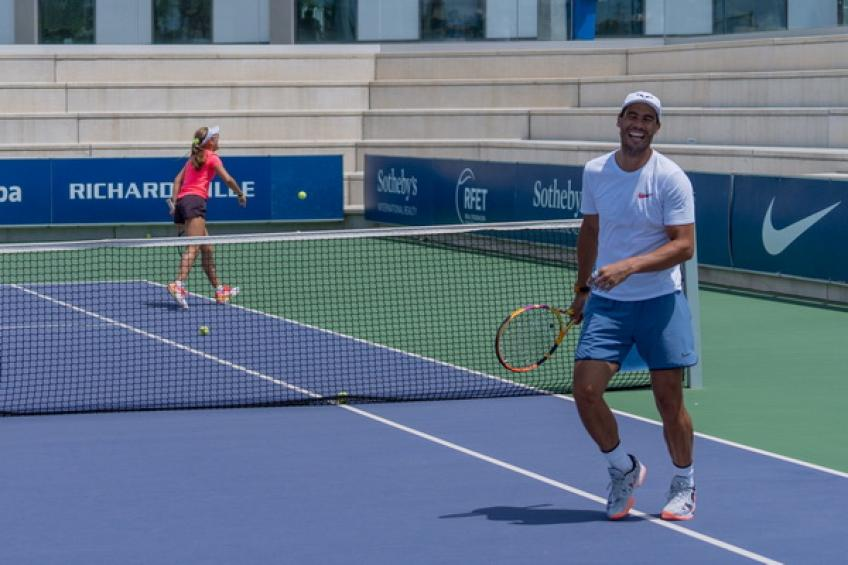 Rafael Nadal and Carlos Moya play doubles against juniors at Rafa Academy