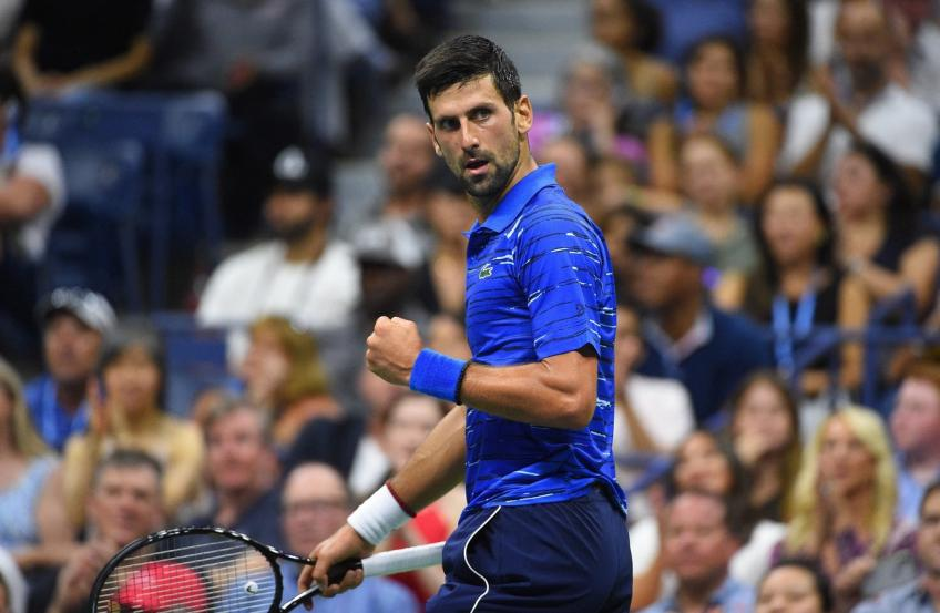 Djokovic fights through neck pain to beat Berankis