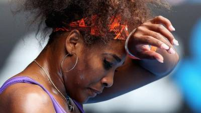 Serena Williams becomes a ball picker during Venus Williams´ practice