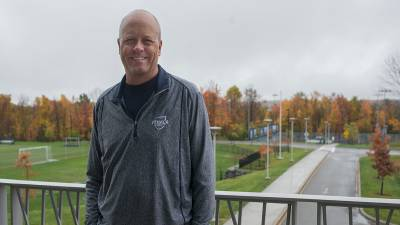Ithaca College tennis coach writes name in record books!