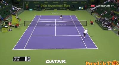 Melzer hits a drop shot but Murray is unbelievably fast