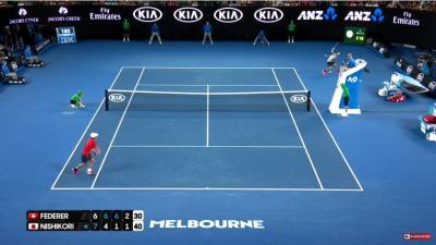 Federer hits a crazy backhand around the net post!
