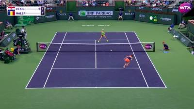 Vekic hits a drop shot, but Halep puts her quick feet on display!