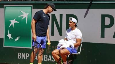 Nadal, Djokovic march on as Muguruza survives
