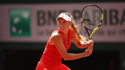 Wozniacki returns to French Open quarterfinals with triumph over Kuznetsova