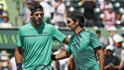 Tennis-Federer seeks historic eighth title but faces test from Cilic