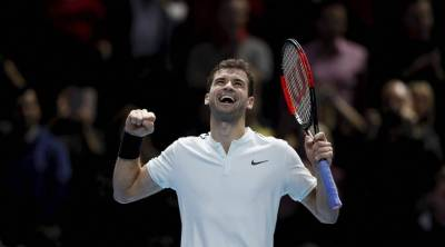 Dimitrov thrashes Goffin to reach semi-finals