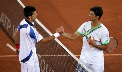 Djokovic battles through Bellucci to set up another clash with Nadal