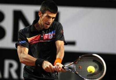 Djokovic battles past Murray and Nadal cruises past Gasquet
