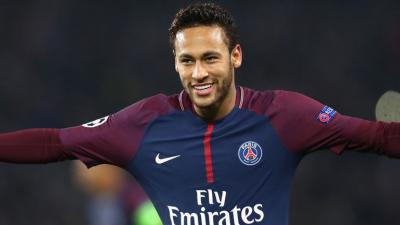 On what does football star Neymar Jr. splurge his earnings?