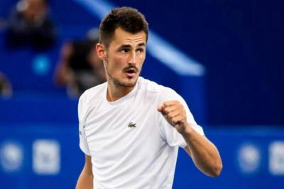 Bernard Tomic remains hopeful he could one day win Grand Slam