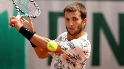 Corentin Moutet getting his just desserts at the French Open