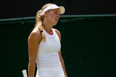 Wozniacki on loss: 'How are we playing with HawkEye that is this bad?'