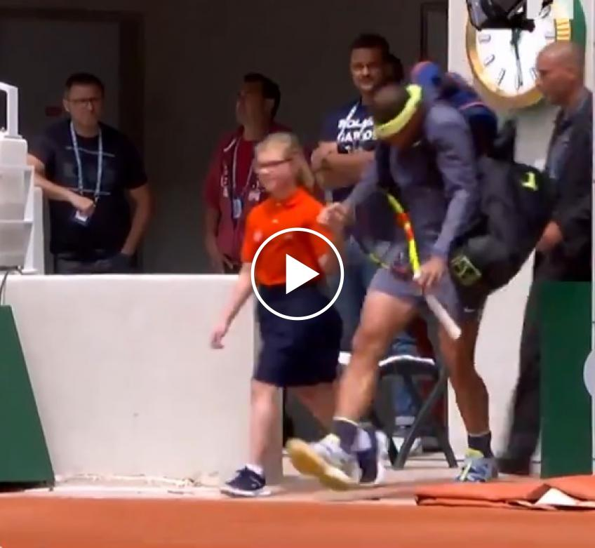 Rafael Nadal bangs head on camera before French Open match