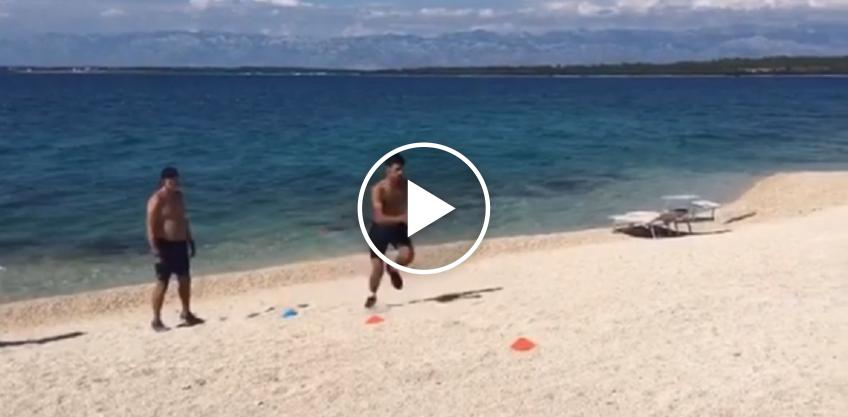 Novak Djokovic trains on the beach in Zadar