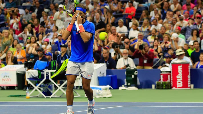 Rafael Nadal, of Spain, rubs his eyes during play against Lucas Pouille